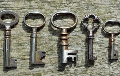 Five very small Antique  pipe Keys on weathered wood